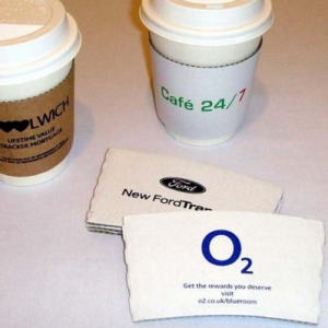 Our custom printed coffee sleeves are a superb way of getting your message across and to promote your brand and with a larger print area than paper cups, our clutches are the ideal solution for branding plain unprinted paper cups. Our coffee cup sleeves are manufactured from 100% recycled fibre/cardboard Available in two sizes to fit 8-10oz cups and 12-20oz cups in your choice of white or brown They can be printed in 1, 2 or 3 spot Pantone colours There is no minimum order for printing spot colours and are available printed in just 48 hours Our coffee clutches are also available in a 320 micron clutch with all over print coverage for 1 to 101 colours. Printing is available in full colour on the whole outside surface of the sleeve No Minimum Quantity Fast Turnaround Manufactured from 100% recycled cardboard Two sizes available Multi-Colour Prints (subject to artwork) Manufactured in the UK In-House Printing Environment friendly and 100% biodegradable Great for branding plain cups